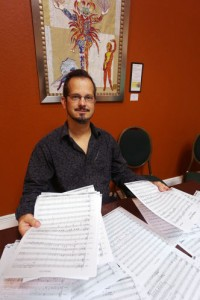 Mark Sforzini shows pages of his unfinished opera, Daisy. In 2007, he left the Florida Orchestra to write an opera based on The Great Gatsby. The project was underwritten by Doyle McClendon. SCOTT KEELER | Times